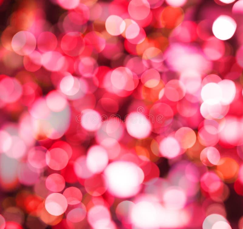 Fondo rojo de la chispa con la luz abstracta del brillo del bokeh fotografía de archivo