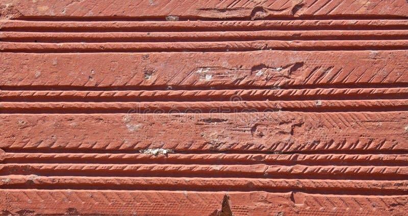 Fondo rojo de la pared de ladrillo imagen de archivo