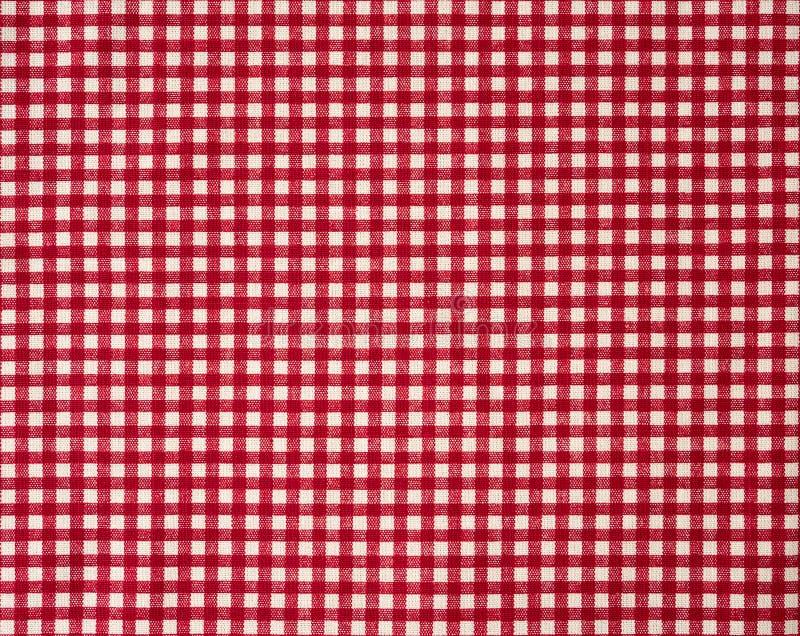 Fondo rojo de la textura de la tela del modelo de la guinga del ladrillo refractario imagen de archivo libre de regalías