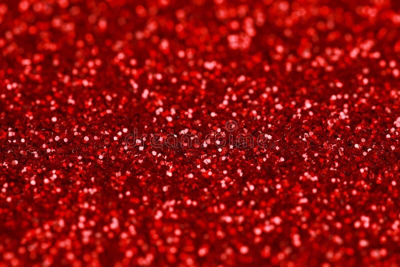Fondo rojo del brillo de la chispa Textura del extracto del día de fiesta, de la Navidad, de las tarjetas del día de San Valentín fotos de archivo
