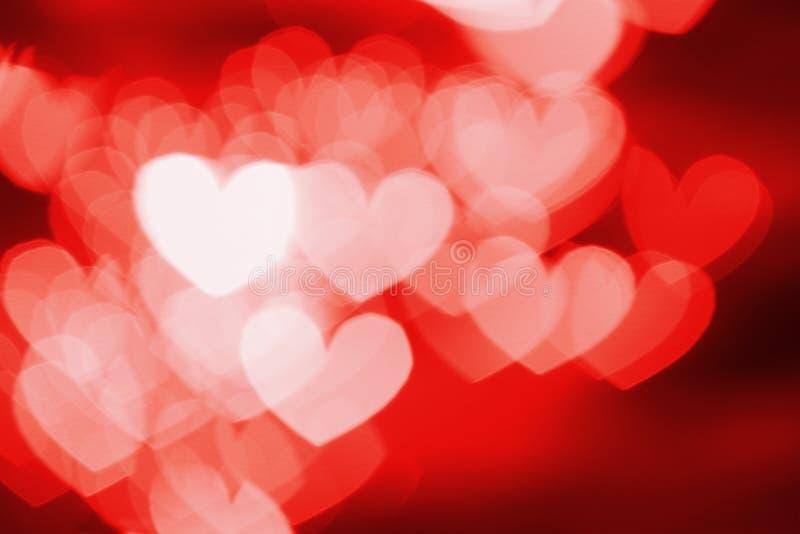 Fondo rojo del extracto del bokeh de los corazones foto de archivo