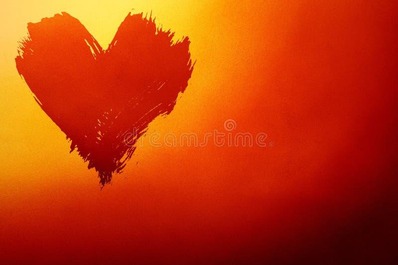 Fondo rojo y amarillo abstracto con el corazón fotografía de archivo libre de regalías