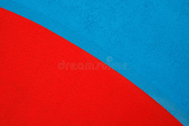 Fondo Rojo Y Azul Del Piso De La Resina De Acrílico Foto