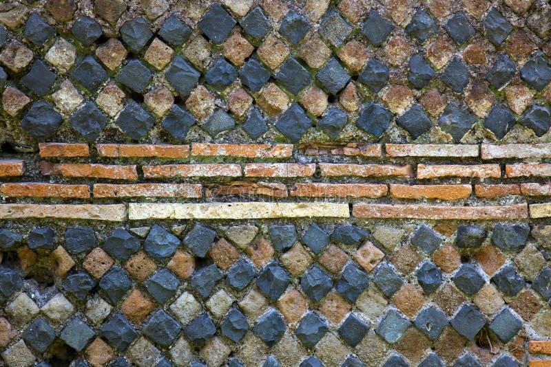 Fondo romano antiguo Ostia Antica de la pared de piedra fotografía de archivo libre de regalías