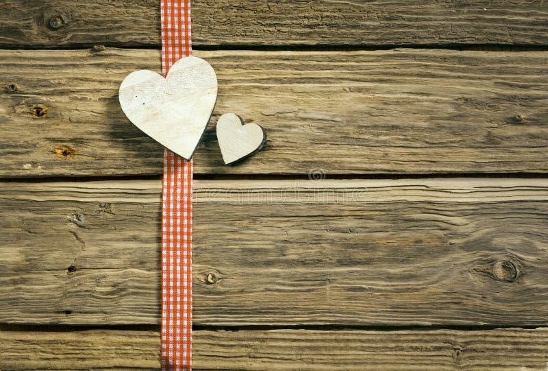 Fondo romantico di Natale con i cuori immagini stock