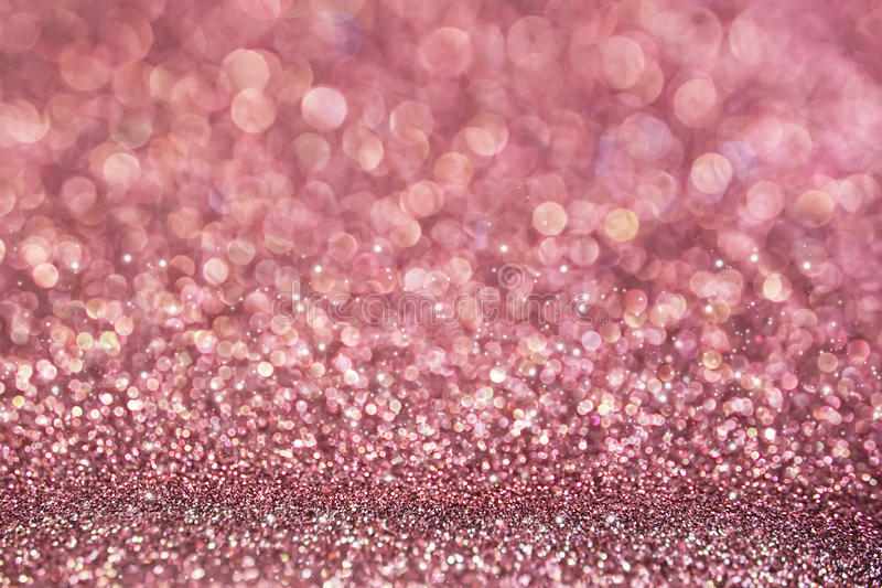 Fondo rosa dorato del bokeh di struttura di scintillio della sfuocatura fotografia stock
