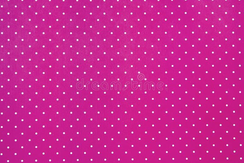 Fondo rosado abstracto con los puntos blancos foto de archivo