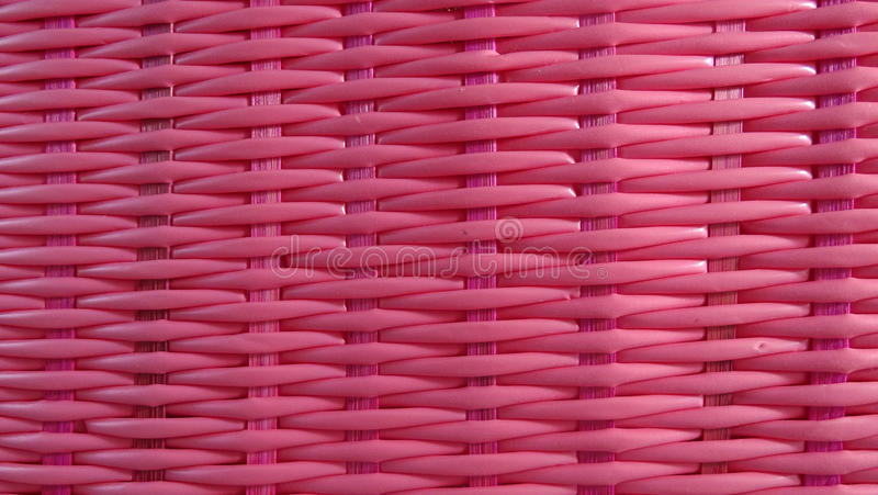 Fondo rosado de la armadura de cesta foto de archivo