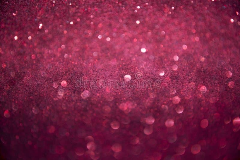 Fondo rosado que brilla, luces chispeantes abstractas, textura brillante que brilla intensamente festiva elegante fotografía de archivo libre de regalías