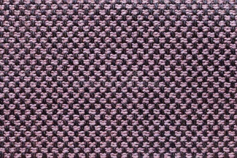 Fondo rosado y negro de la materia textil con el modelo del ajedrez, primer Estructura de la macro de la tela imagen de archivo libre de regalías