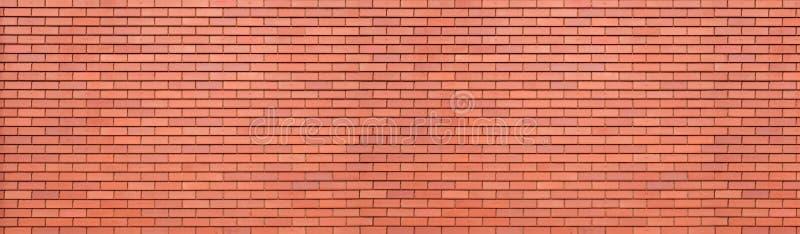 Fondo rosso astratto di struttura del muro di mattoni Vista panoramica orizzontale del muro di mattoni della muratura fotografia stock libera da diritti