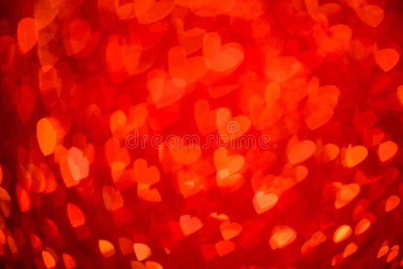 Fondo rosso del bokeh del cuore Struttura di giorno di biglietti di S. Valentino immagini stock libere da diritti