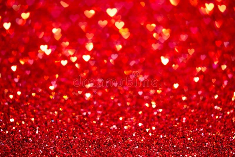 Fondo rosso del bokeh del cuore Struttura di giorno di biglietti di S. Valentino fotografie stock libere da diritti