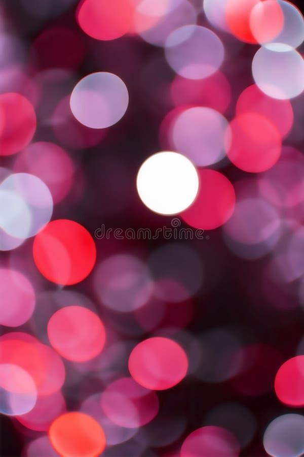 Fondo rosso delle luci del bokeh del nuovo anno e di Natale fotografia stock