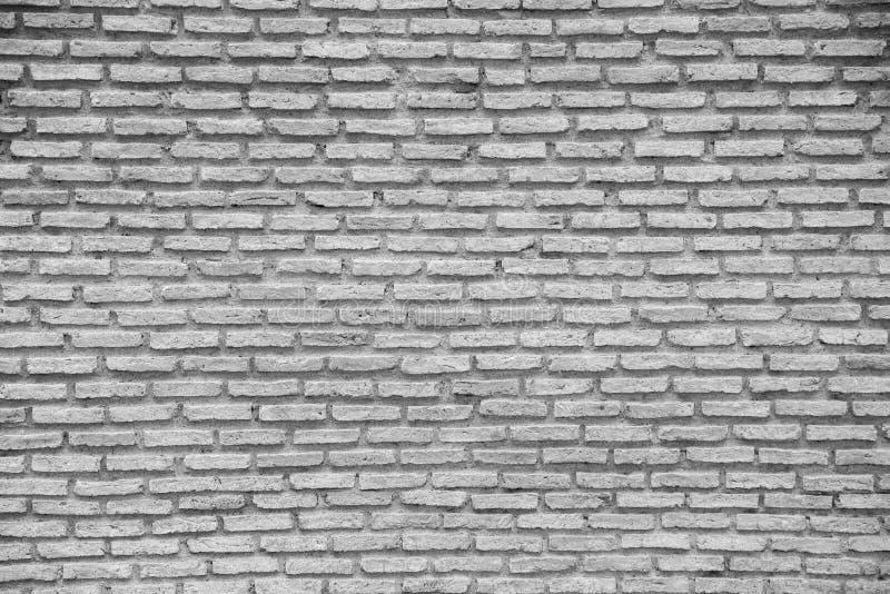 Fondo senza cuciture e modello del muro di mattoni di pietra immagine stock libera da diritti