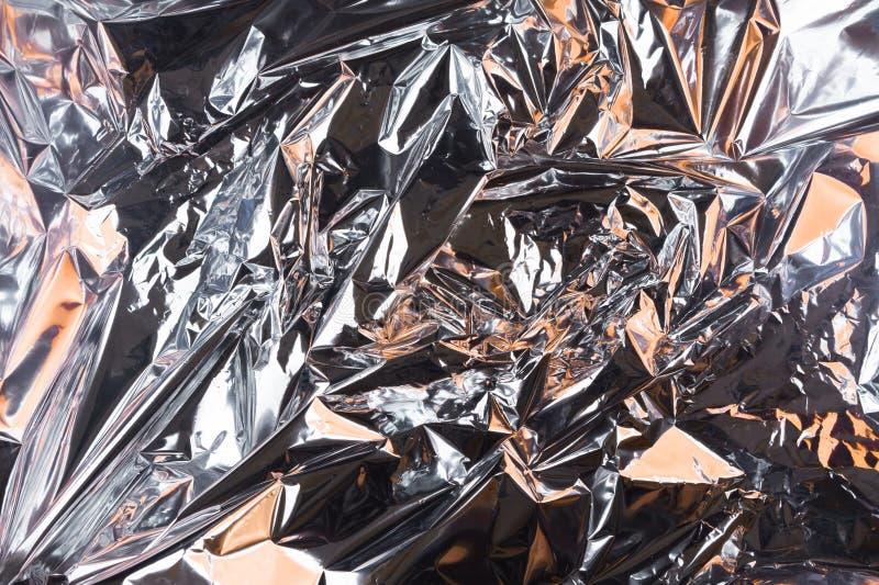 Fondo sgualcito astratto della stagnola Fondo della foto di lerciume Ombre arancio fotografia stock libera da diritti