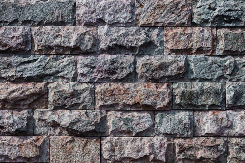 Fondo, struttura di una da una pietra naturale colorata multi fotografie stock