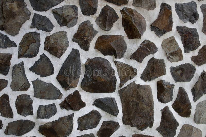 Fondo, struttura di una parete decorata con la pietra del granito fotografie stock libere da diritti