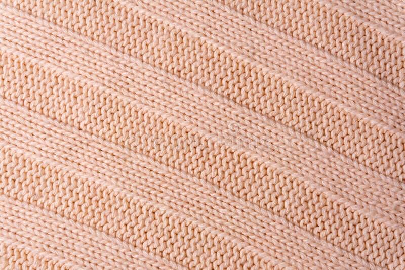 Fondo, struttura - superficie di una fine del tessuto tricottata lana su fotografia stock libera da diritti