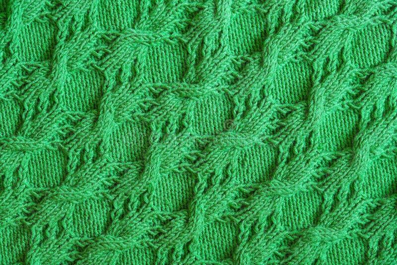 Fondo strutturato astratto di tricottare verde fotografie stock libere da diritti
