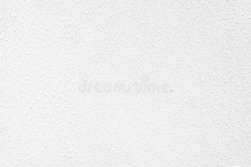 fondo strutturato concreto colorato bianco di contrasto basso con rugosità e le irregolarità fotografie stock