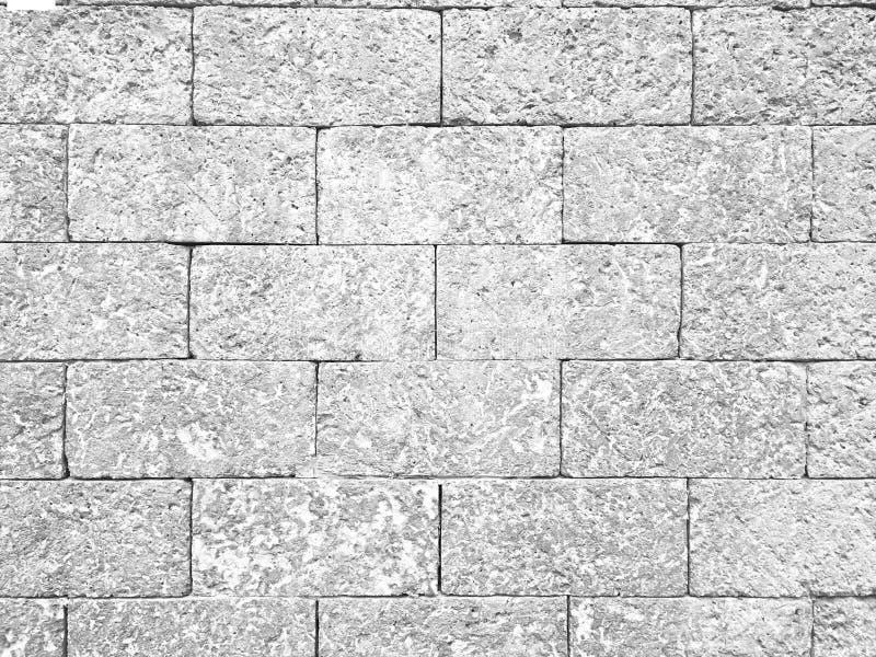 Fondo strutturato del vecchio retro del semitono muro di mattoni della laterite immagine stock