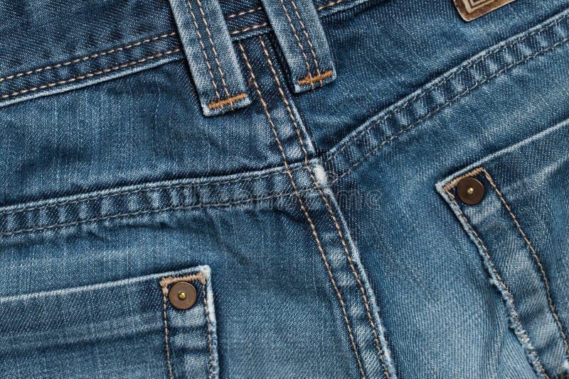 Fondo strutturato delle blue jeans con i punti immagini stock