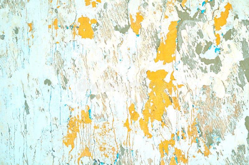 Fondo strutturato dello stucco - stucco beige leggero della sbucciatura e pittura luminosa della sbucciatura arancio immagini stock libere da diritti