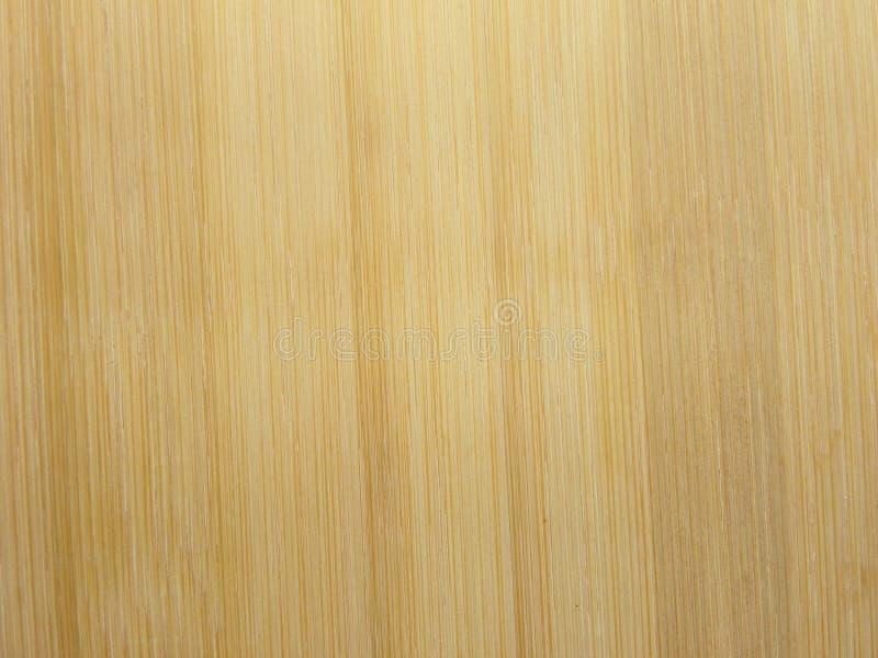 Fondo strutturato di legno di bambù giallo-chiaro fotografia stock libera da diritti