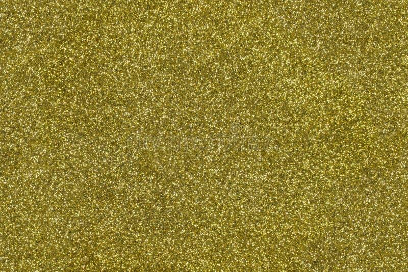 Fondo strutturato di scintillio dell'oro Contesto frizzante brillante fotografia stock libera da diritti