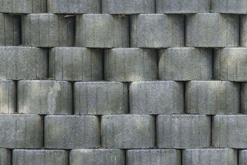 Fondo strutturato grigio con gli oggetti rotondi Superficie bulbosa e ruvida Grande parete grigia con molti oggetti fotografia stock libera da diritti