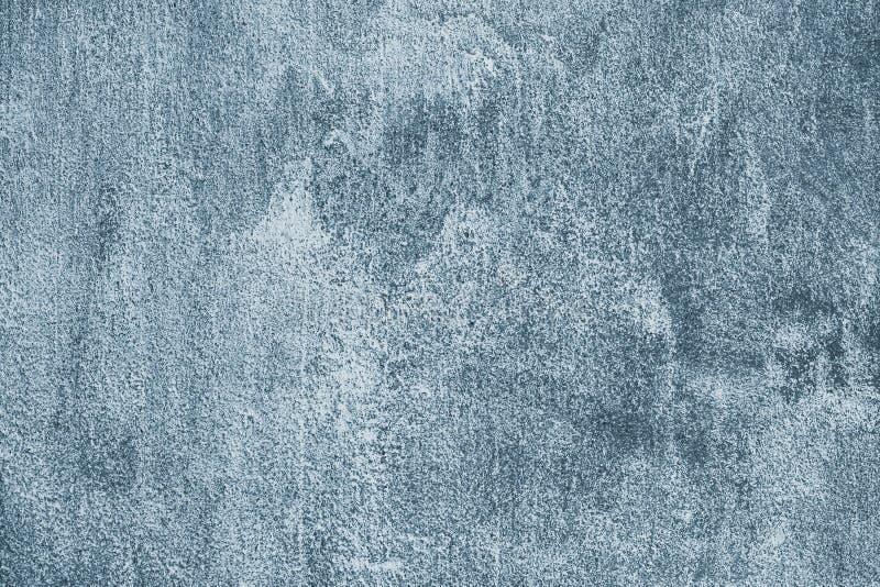 Fondo sucio gris oscuro y azul Modelo abstracto de la pared pintada concreta sucia Pared vieja sucia urbana Superficie de piedra  imagen de archivo libre de regalías