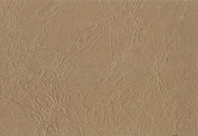 Fondo textura del papel de embalaje marrón arrugado técnico al fondo creativo del diseño Kraft deformado foto de archivo libre de regalías