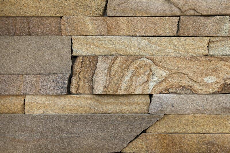 Fondo, textura, poniendo sombras de piedra naturales del marrón y de la arena fotografía de archivo