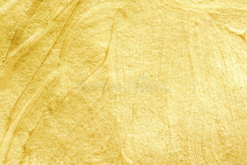 Fondo texturizado acuarela de oro Oro abstracto que brilla imagenes de archivo