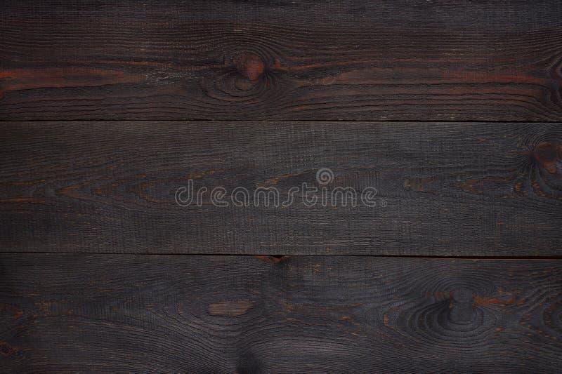 Fondo texturizado de madera marrón oscuro fotos de archivo