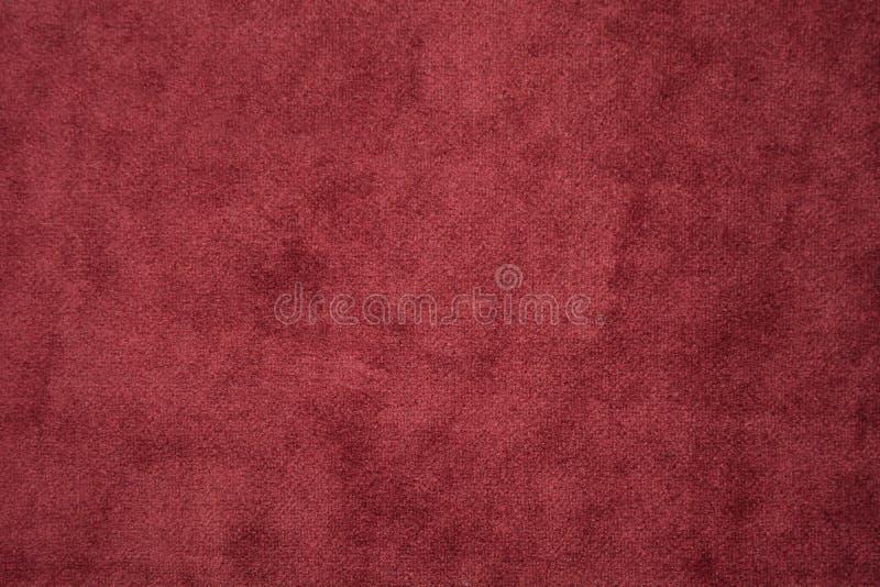 Fondo texturizado extracto rojo del terciopelo del material de materia textil Copie el espacio foto de archivo