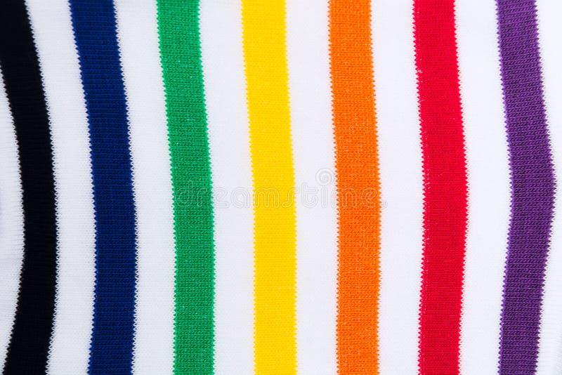 Fondo texturizado materia textil rayada colorida de la tela de la impresión Endecha plana fotos de archivo
