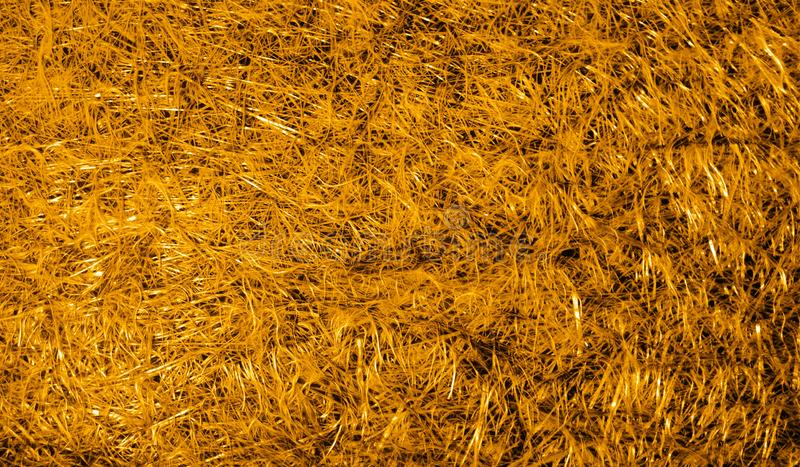 Fondo texturizado metálico brillante sombreado de oro del extracto con efectos luminosos Fondo, papel pintado fotos de archivo