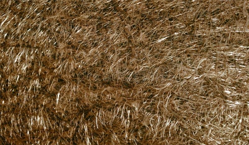 Fondo texturizado reluciente metálico brillante marrón del extracto con efectos luminosos Fondo, papel pintado fotografía de archivo