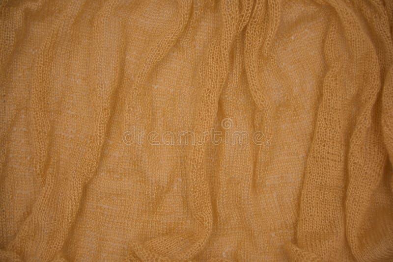 Fondo tricottato arancio sporco del modello di struttura fotografia stock