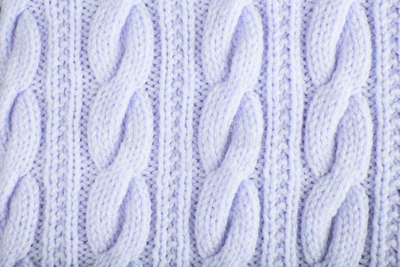 Fondo tricottato del jersey con un modello in rilievo immagini stock libere da diritti