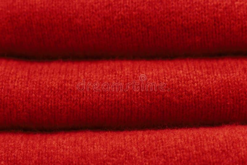 Fondo tricottato di lana arancio ruggine di tendenza, struttura, primo piano immagine stock libera da diritti
