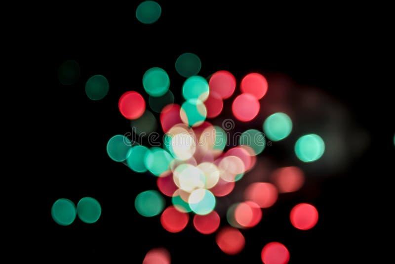 Fondo variopinto delle particelle di Bokeh di esplosione dei fuochi d'artificio fotografie stock