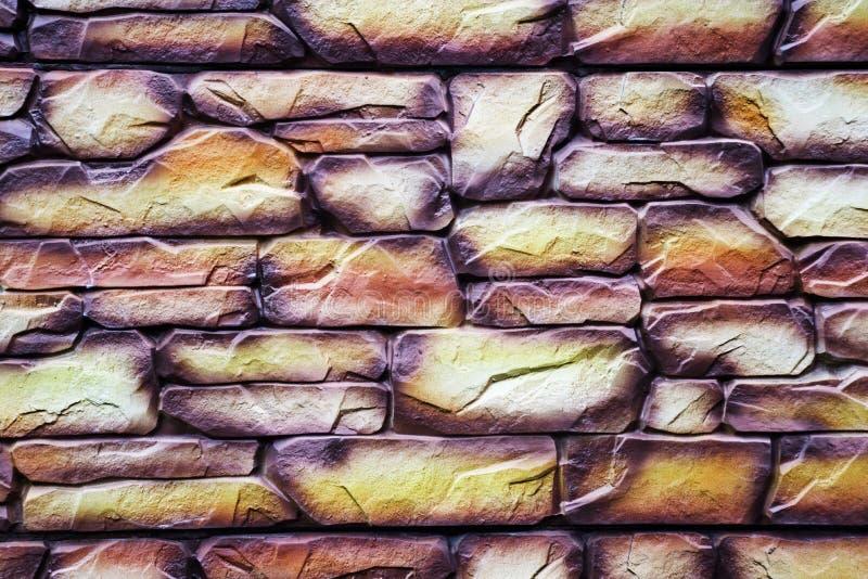 Fondo variopinto di struttura del mattone della parete di pietra fotografia stock libera da diritti