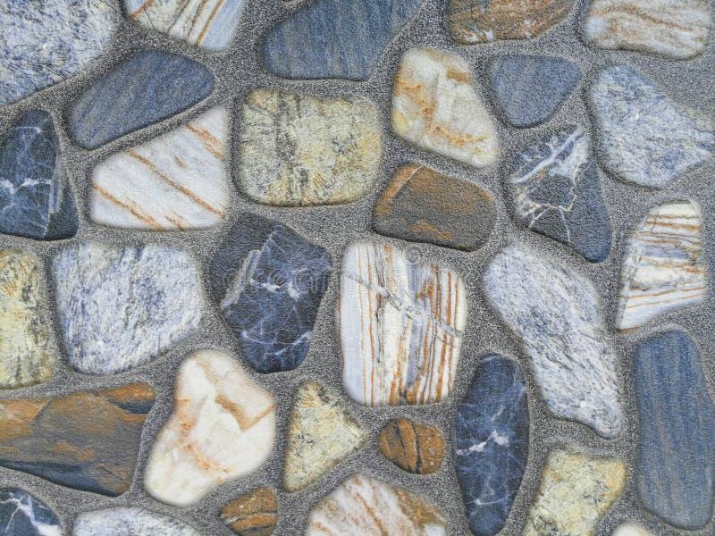 Fondo variopinto e struttura della superficie della parete di pietra della roccia fotografie stock