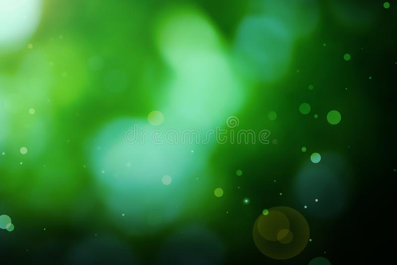 Fondo verde astratto della natura con la lente & le particelle immagini stock