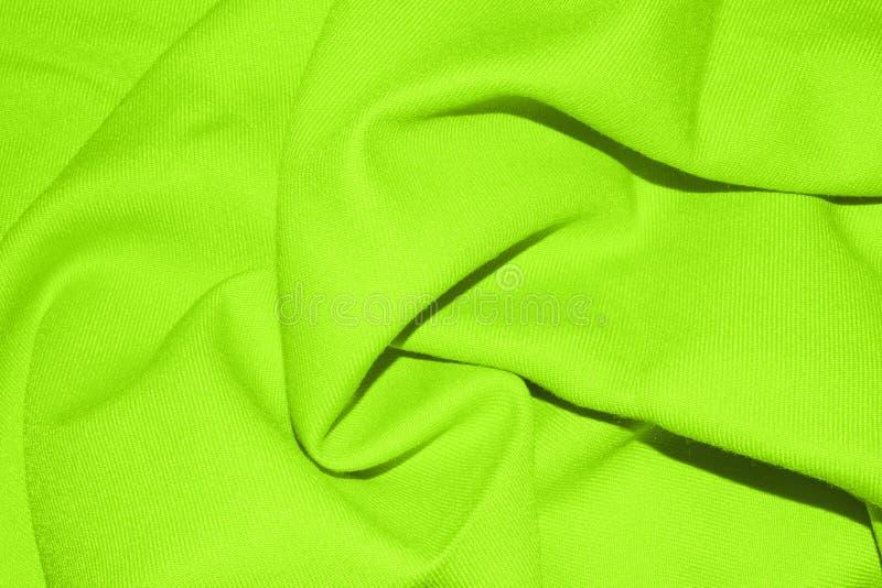 Fondo verde chiaro del tessuto con le pieghe fotografia stock