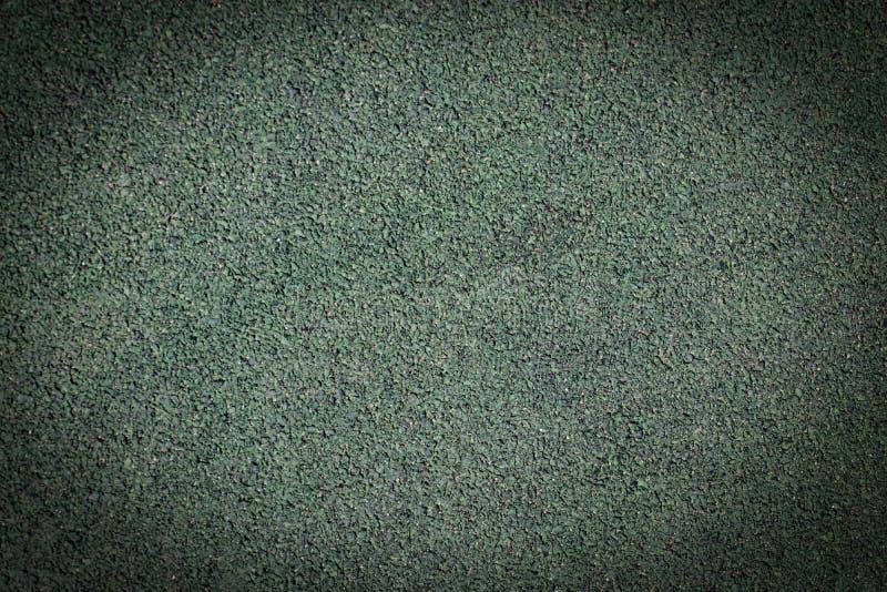 Fondo verde con el proyector Asfalte el fondo de la textura imagen de archivo libre de regalías