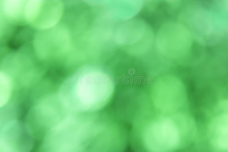 Fondo verde del bokeh vago estratto fotografie stock libere da diritti
